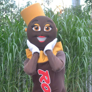 Rolo character posing for photo with two boys at Hersheypark