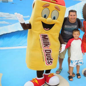 Milk Dud Character posing for photo with dad and his son