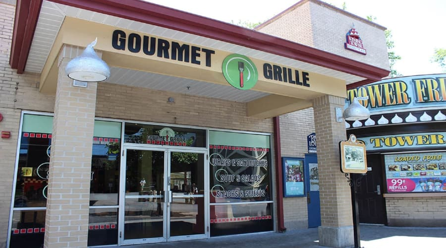 Gourmet Grill exterior building with two glass doors