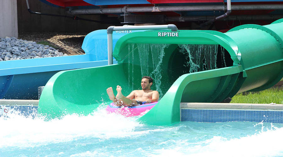 Man riding Coastline Plunge Riptide water slide