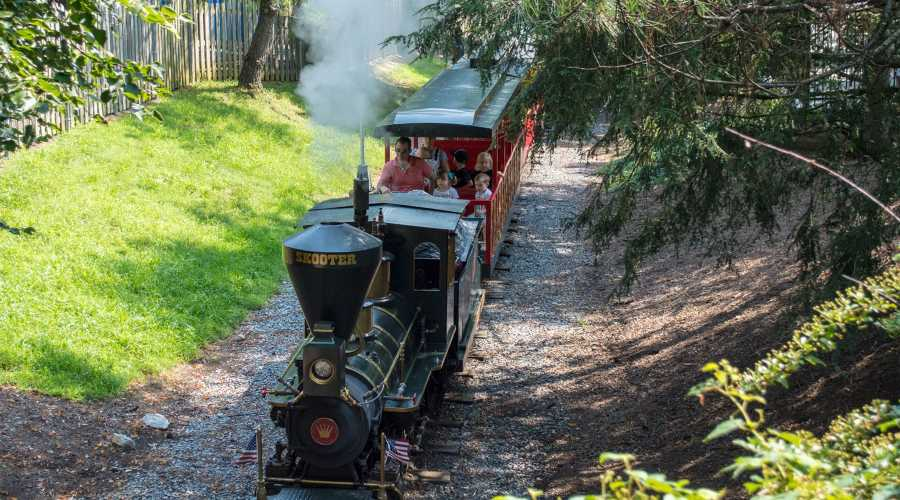 People riding on the Dry Gulch Railroad ride
