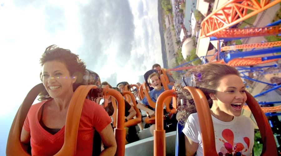 Mom and Daughter riding front row Fahrenheit Coaster