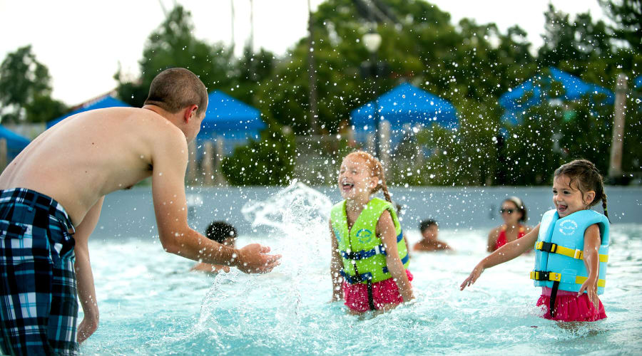 Dad Splashing 2 Daughters in Life Vests at The Shore water Attraction at Hersheypark