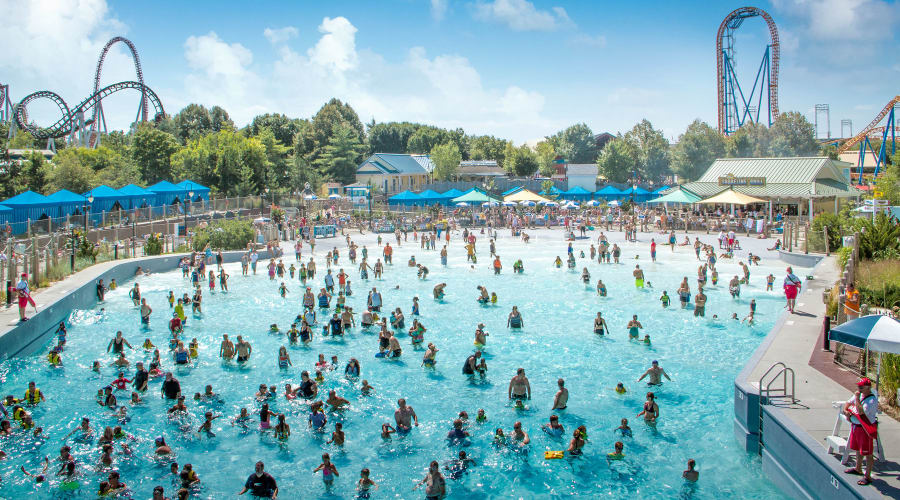 Beautiful View of People in the Shore Wave Pool at Hersheypark with Coasters in the Background