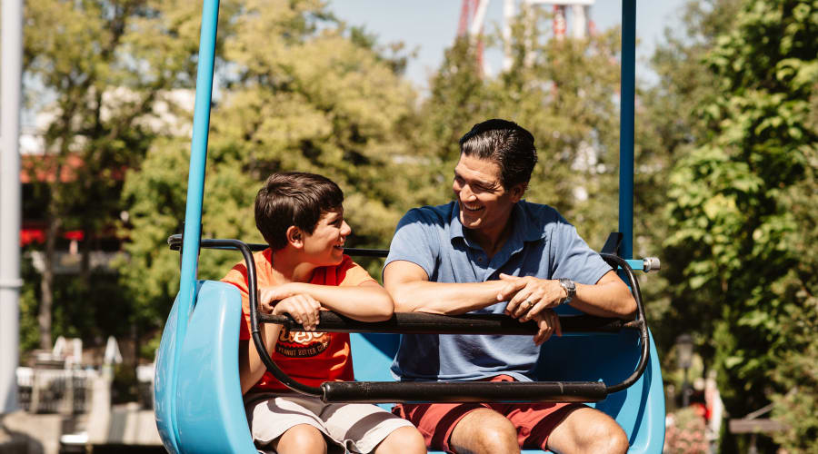 Father and Son smiling at each other on Skyview ride at Hersheypark