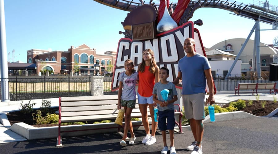 family in front of candymonium